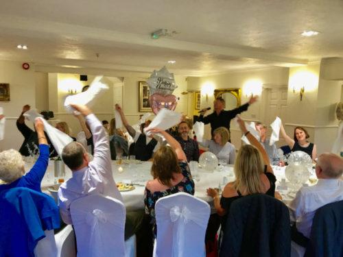 Napkin Waiving Singing Waiters